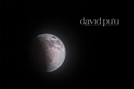 An awesome full moon by legendary photographer, David Pu'u